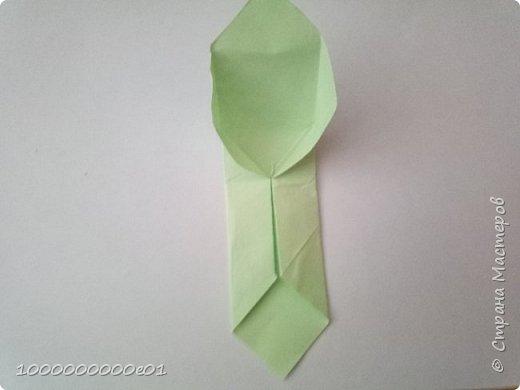 Вам понадобятся 2 листа бумаги (один - для корпуса, другой - для паруса) и ножницы. фото 7