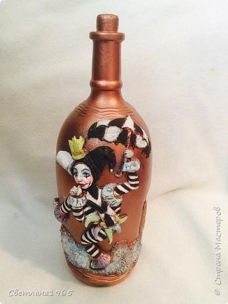 Приветствую всех!Бутылка покрашена черной краской,потом медной,лицо из хол . фар.Картинка взята из инета фото 3