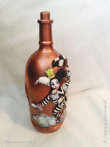 Приветствую всех!Бутылка покрашена черной краской,потом медной,лицо из хол . фар.Картинка взята из инета фото 4