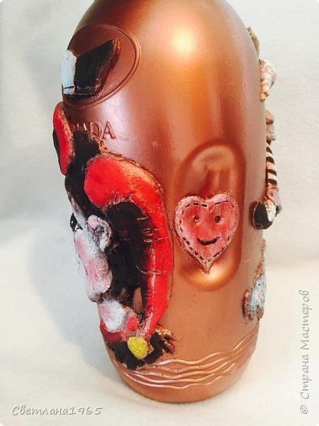 Приветствую всех!Бутылка покрашена черной краской,потом медной,лицо из хол . фар.Картинка взята из инета фото 8