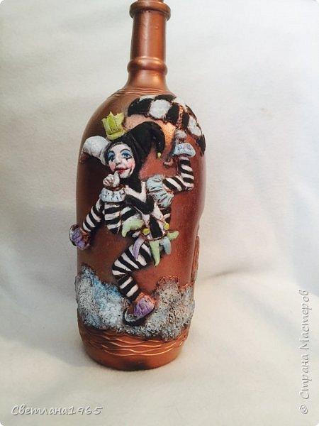 Приветствую всех!Бутылка покрашена черной краской,потом медной,лицо из хол . фар.Картинка взята из инета фото 1