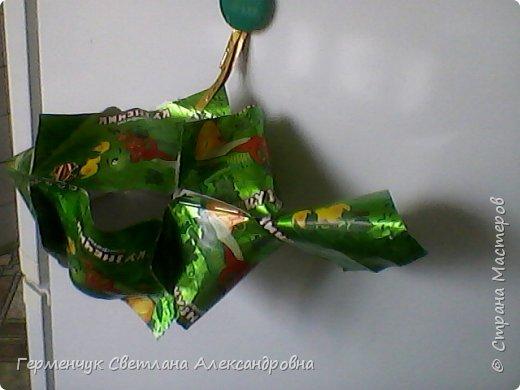 Представляю вашему вниманию  сувенирную объемную рыбку ( оригами) , которую можно использовать как упаковку небольшого подарка .(Увидела в Интернете) фото 8