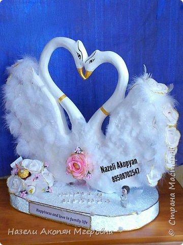 Свадебные лебеди из конфет  фото 1