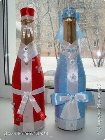 Дед Мороз и Снегурочка на бутылках