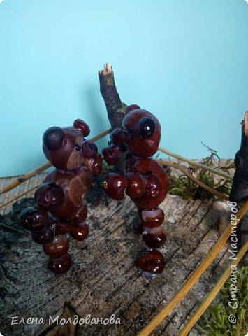 Павлины сделаны из шишек, камыша, высушенных цветов, мха и сухоцветов фото 7
