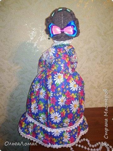 Кукла на чайник сделана из натуральных материалов, в мешочке лежат травы: чабрец , душица, зверобой.  фото 2
