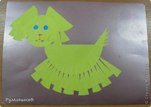 Я выбрала день домашних животных.Когда слово идёт о домашних животных,в голову приходят кошка с собакой.Поэтому я, недолго думая, решила их смастерить. Вот так выглядит моя собачка.Чтобы его изготовить,приготовили цветной картон,цветную бумагу,ножницы,клей.Из цветой бумаги вырезали детали,потом склейли их. фото 1