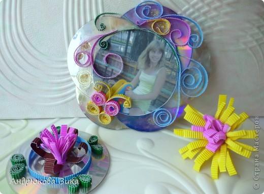 Фоторамка из СД дисков выглядит оригинально и очень красиво. фото 1