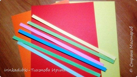 Петушок. Выполнен из цветного картона и бумаги. Может украсить полочку с книгами, повисеть на елочке, а может даже спрятать внутри себя подарочек. фото 2