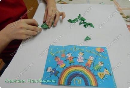 Это наша попытка изобразить матрешку в удмуртском костюме в технике модульного оригами. фото 3