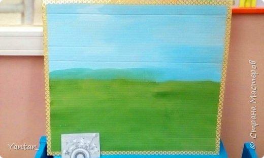 Воспитанники старшей группы выполнили поделку в виде весёлой цветочной клумбы. фото 2