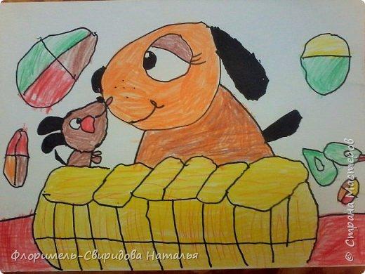 Собачка со щенком играют в корзинке, а из нее сыпятся игрушки. фото 6