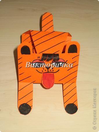 Тигрёнок. Вырезание бумажных  фигурок  животных. фото 1