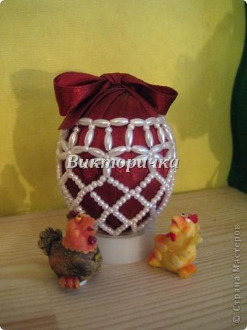 Яицо, обмотанное бичёвкой и украшенное цветами.   фото 3
