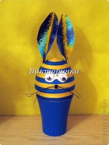 Яицо, обмотанное бичёвкой и украшенное цветами.   фото 7