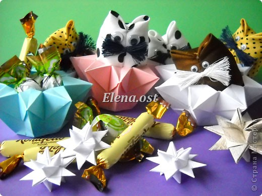 При копировании статьи, целиком или частично, пожалуйста, указывайте активную ссылку на источник! http://stranamasterov.ru/user/9321 http://stranamasterov.ru/node/120275 Коробочка-звездочка в технике оригами. Можно положить сладкий подарок, мягкую игрушку, украшения и поставить под елочку от Деда Мороза. Из цветной бумаги для принтера (квадрат 21х21) получается коробочка в диаметре 11 см (по крайним точкам). фото 38