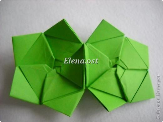 Кусудама Enrica. 60 модулей. Собираем 12 цветов-звездочек на клей по пять модулей. При квадрате 5Х5 см размер кусудамы 8 см, при 7Х7 см - 12 см. Бумагу лучше брать офисную для принтера или специальную для оригами. При копировании статьи, целиком или частично, пожалуйста, указывайте активную ссылку на источник! http://stranamasterov.ru/node/157778 http://stranamasterov.ru/user/9321  фото 30