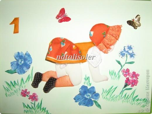 """""""К """"полету готова!""""Эта малышка, кувыркающаяся на весеннем лугу, сделана  в технике инкрустации ткани по картон-муссу. Фон -наклеенная цветная бумага, цветы вырезаны из ткани, травка прорисована фломастерами. фото 1"""