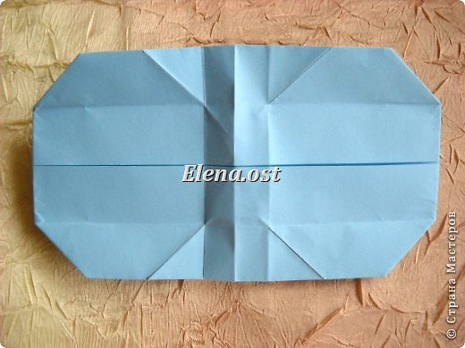 Сумочка-оригами для сладостей. Приятно дарить подарок в маленькой сумочке-бонбоньерке. Я сделала сумочку с сердцем из офисной бумаги. Формат А4. Размер сумочки 5.5Х8 см. При копировании статьи, целиком или частично, пожалуйста, указывайте активную ссылку на источник! http://stranamasterov.ru/user/9321 http://stranamasterov.ru/node/144940 фото 19