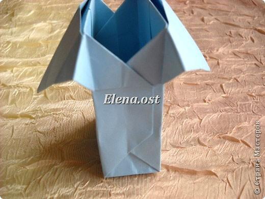 Сумочка-оригами для сладостей. Приятно дарить подарок в маленькой сумочке-бонбоньерке. Я сделала сумочку с сердцем из офисной бумаги. Формат А4. Размер сумочки 5.5Х8 см. При копировании статьи, целиком или частично, пожалуйста, указывайте активную ссылку на источник! http://stranamasterov.ru/user/9321 http://stranamasterov.ru/node/144940 фото 23