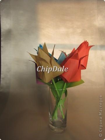 Здравствуйте, дорогие мастера и мастерицы! Первый раз в жизни делала оригами. Получились 6 тюльпанчиков - 5 в подарок к 8 марту соседям, а 6 - мне, на память. :) фото 1