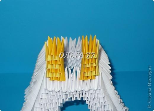 Для данного изделия понадобится: всего 1048  модулей.  Размер используемого модуля  1\32 часть листа, формата А4 Использовалась бумага белого цвета, клей ПВА, балончик с аэрозольной краской серебристого цвета.  фото 29