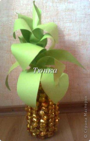 Вот такой ананас получился у меня в подарок на день рождения. Для листиков использовала бумагу формата А4. немножко притонировала серединку листиков обычной акварелью. Огромное спасибо за множество МК по ананасу в Стране!!!!! фото 2